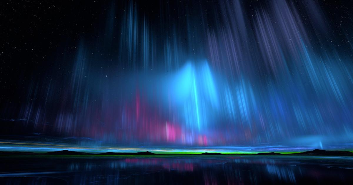 Le phenomene des lumieres d'une aurore qui se pare de differentes couleurs